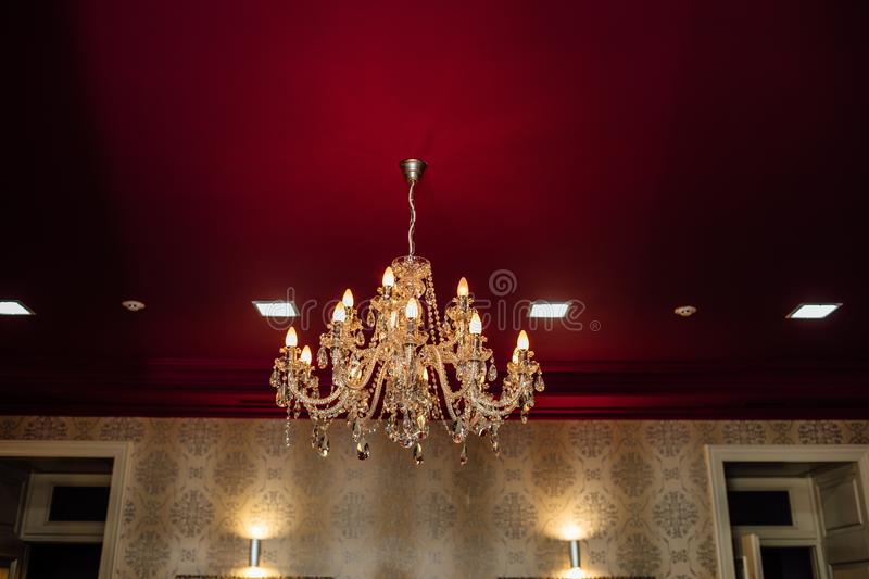 Chrystal chandelier close-up. In light background stock images