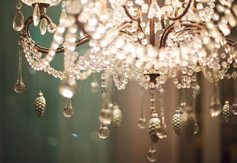 Chrystal chandelier close up. Glamour background with copy space royalty free stock images