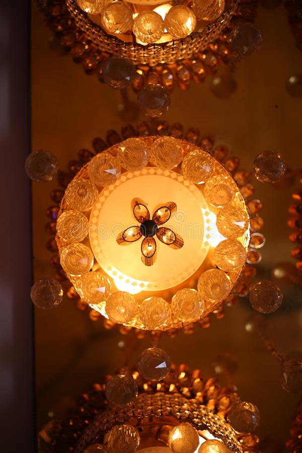 Chrystal chandelier close up. Glamour background with copy space. Chrystal chandelier lamp on the ceiling in Dining room Adjusting the image in a Luxury tone stock photo