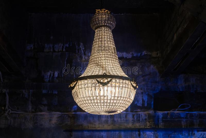 Chrystal chandelier lamp on the ceiling in the club. Decorative. Elegant vintage and contemporary interior element stock photos