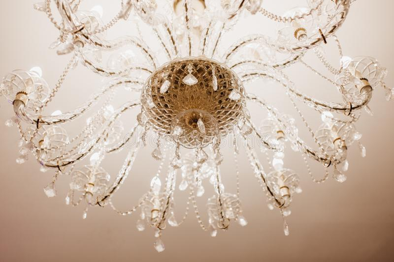 Chrystal Chandelier Lamp Close-up White Background. Macro Photo of Decorative Elegant Vintage and Contemporary Interior Shine Concept royalty free stock image