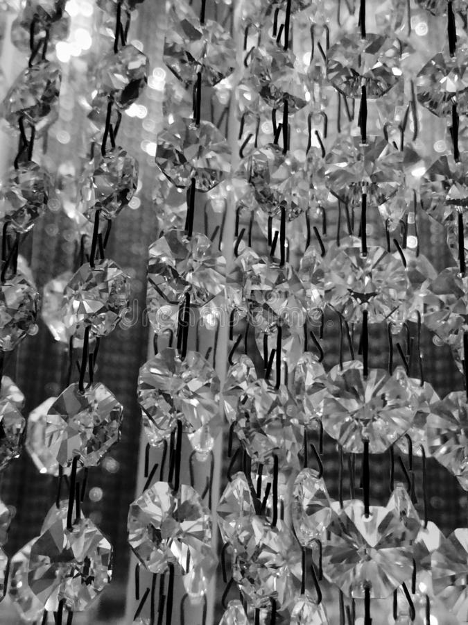 Chrystal with light in black and white. Reflection stock image