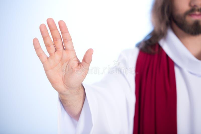 Chrystus pokazuje jego palmy zdjęcia stock
