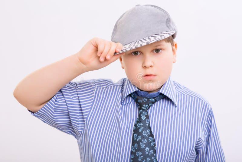 Chubby παιδί που ρυθμίζει την ΚΑΠ του στοκ φωτογραφία με δικαίωμα ελεύθερης χρήσης