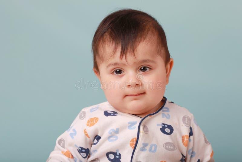 Chubby baby boy. A big chubby boy looking innocent stock photography