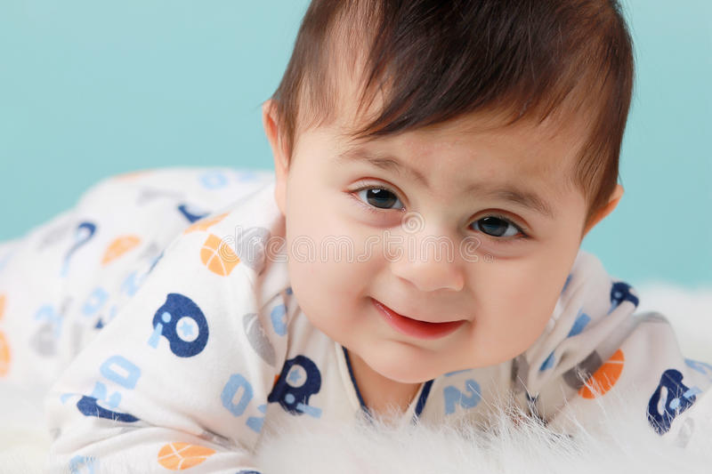 Chubby baby boy. A cute baby boy having some belly time stock photos