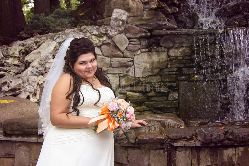 Chubby bride posing royalty free stock images