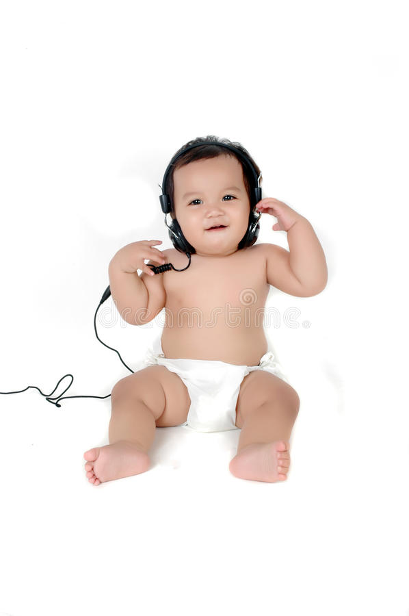 Download A Chubby Little Girl Listen To Music Stock Photo - Image: 19029762