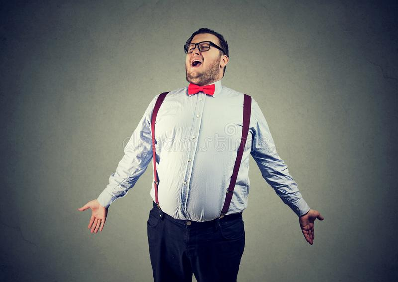 Eccentric chunky man singing opera stock images