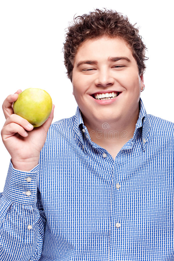 Chubby man holding apple. Happy chubby man holding apple, isolated on white stock photography