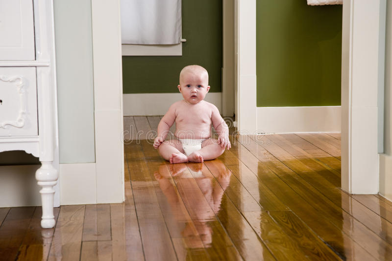 Download Chubby Seven Month Old Baby At Home On Floor Stock Photo - Image: 10749058
