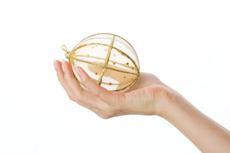 Download Chuchería de oro imagen de archivo. Imagen de mano, esfera - 7289373
