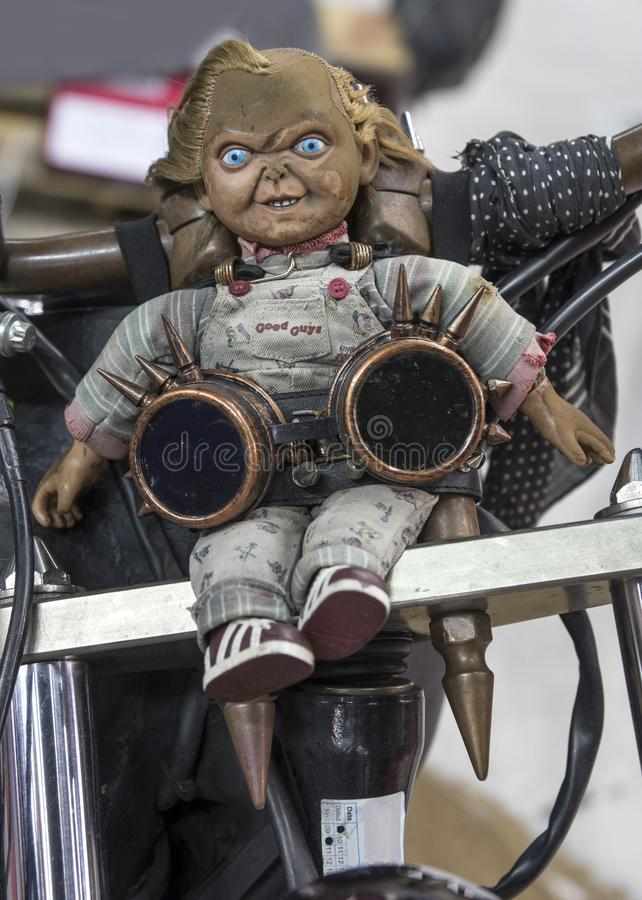 Chucky figurine. Picture of figurine of chucky character from the movie sitting in the front of motorcycle stock photos