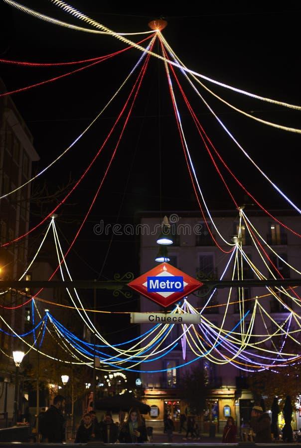 Chueca metro station signboad at night. Madrid, Spain. stock photo