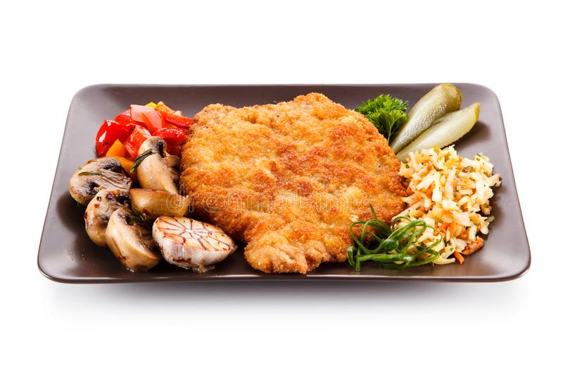 Chuleta de cerdo frita con las verduras fotos de archivo libres de regalías