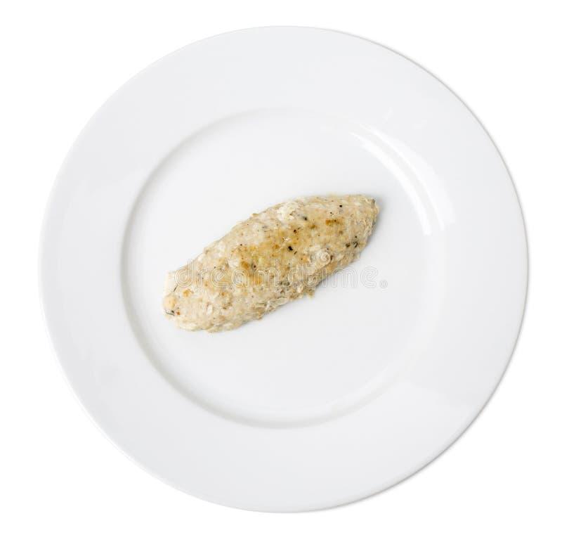 Chuleta deliciosa de los pescados en una placa blanca foto de archivo