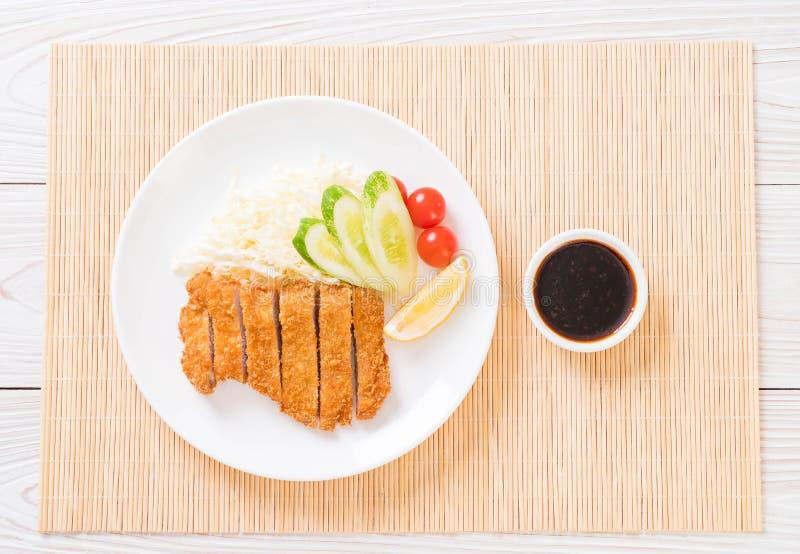 Chuleta frita japonesa del cerdo (sistema del tonkatsu imagenes de archivo