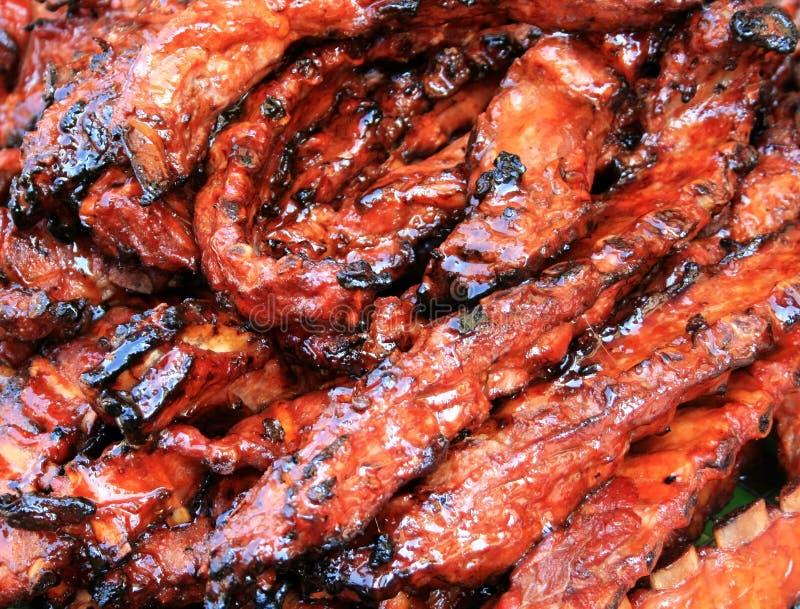 Chuletas de cerdo ahumadas del cerdo de la barbacoa imagenes de archivo