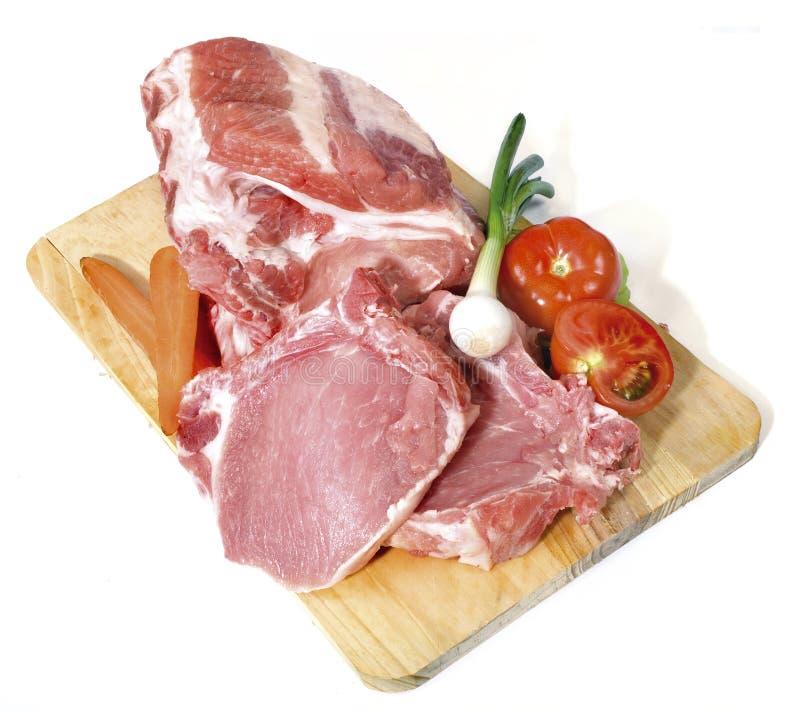 Chuletas de cerdo frescas imagenes de archivo