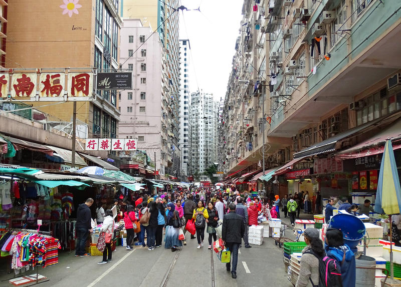 Chun Yeung Street in the North Point district of Hong Kong. North Point, Hong Kong – February 10, 2016: Many people stroll along the many shops on Chun stock images