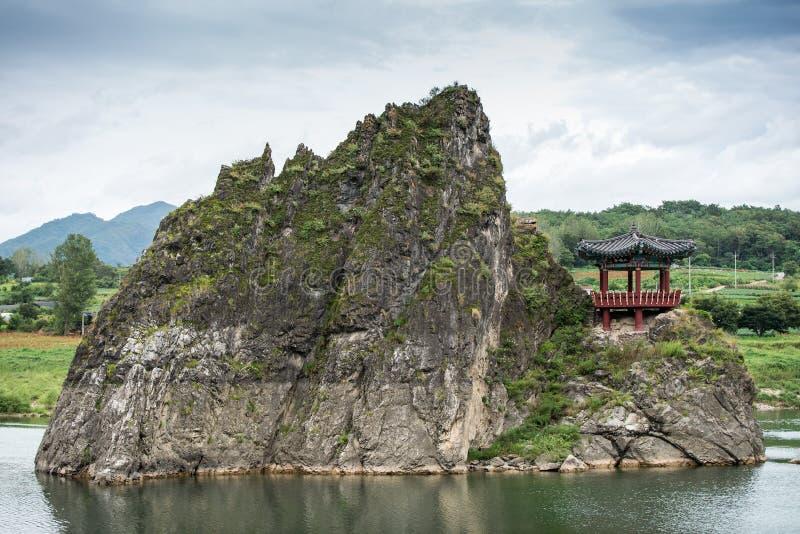 Chungcheongbuk-do, South Korea - August 29, 2016: Dodamsambong are three stone peaks rising out of the Namhangang River. South Korea stock photos