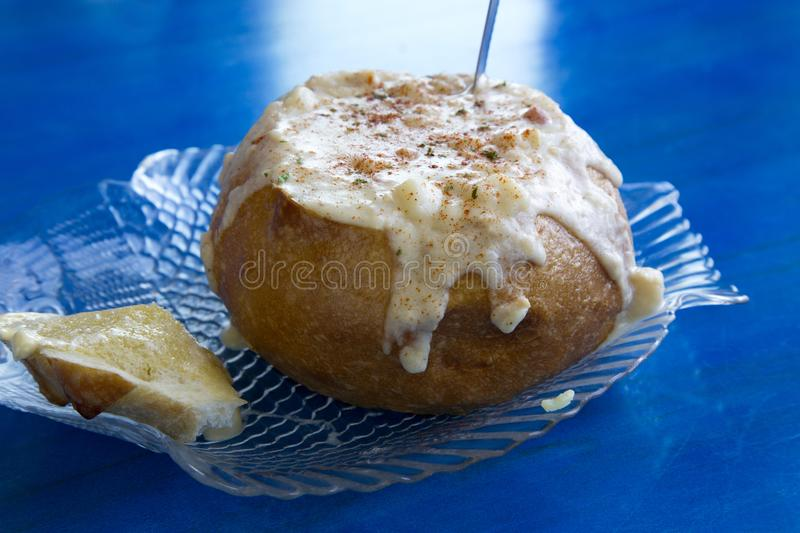 Chunky seafood chowder soup in sourdough bread bowl royalty free stock photography