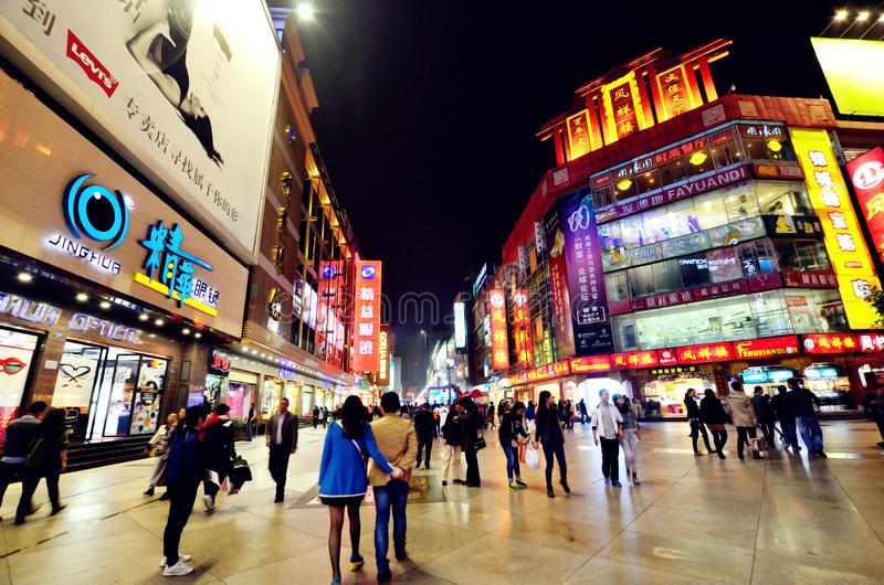Chunxi road in Chengdu,China. Chengdu, China - October 26, 2013: People can seen walking and shopping around the Chunxi road in Chengdu,China at night royalty free stock images