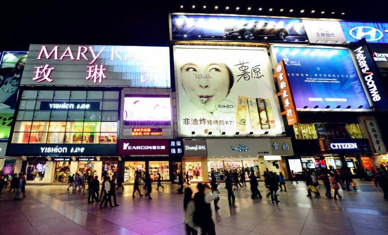 Chunxi road in Chengdu,China. Chengdu, China - October 26, 2013: People can seen walking and shopping around the Chunxi road in Chengdu,China at night royalty free stock image