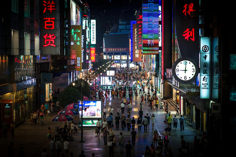 Chunxi Road - Chengdu - Sichuan. Chengdu - May 12 2013: Chunxi Road shopping and pedestrian area view at night with bright and colourful neon signs. May 12, 2013 royalty free stock image