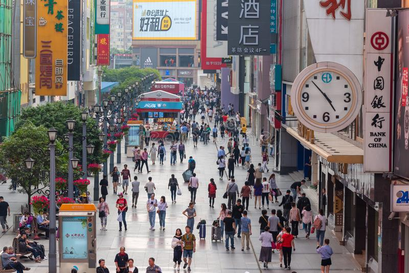 Chunxi road pedestrian shopping street in Chengdu. Chengdu, Sichuan Province, China - April 18, 2018: People on the famous pedestrianized shopping street Chunxi stock photo