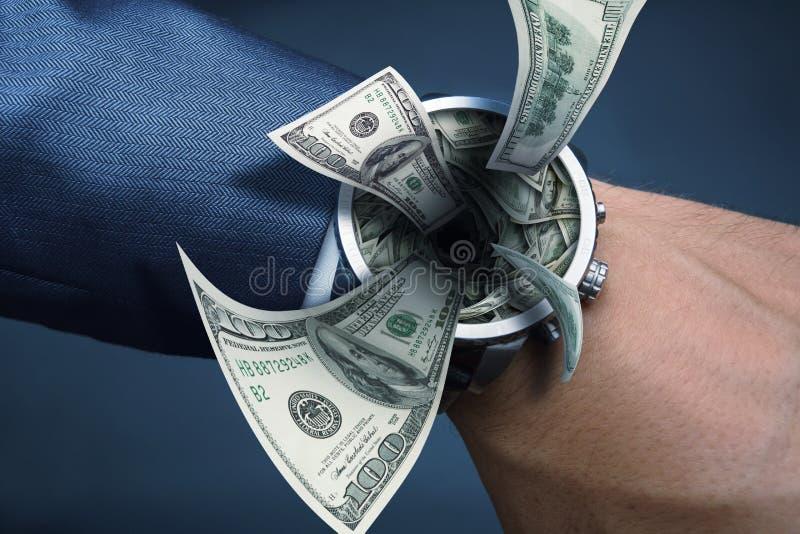 Chupar el dinero imagen de archivo libre de regalías