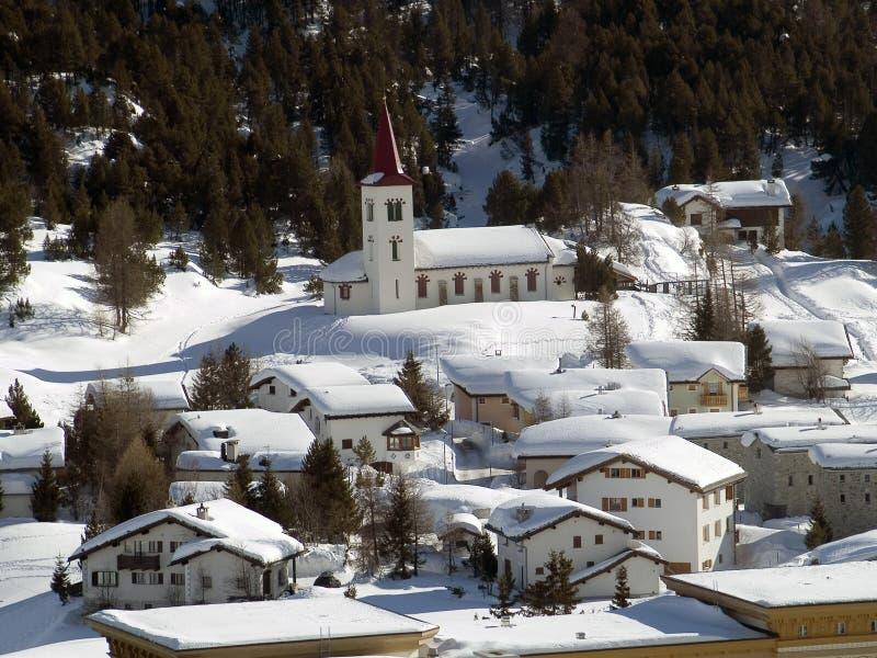 Church. Snowy village in the Alps (switzerland - Maloja royalty free stock photo
