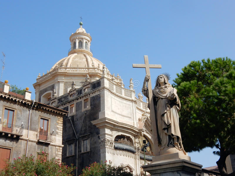 Church of the abbey of Sant Agate with Maria statue - Catania. Baroque style Church of the abbey of Sant Agate with Maria statue and cross – Piazza del stock image