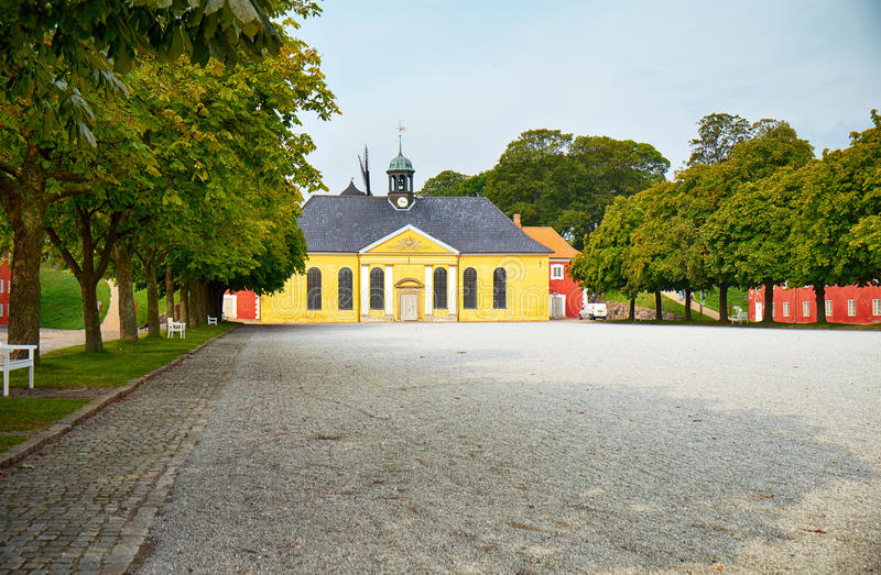 The church and adjacent prison in Kastellet, Copenhagen. The Church at the Citadel was built in 1704 in heavy Baroque style royalty free stock images