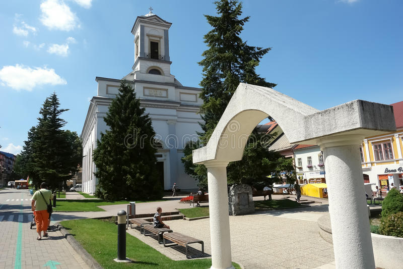 Church and arch in Poprad, Slovakia. royalty free stock images