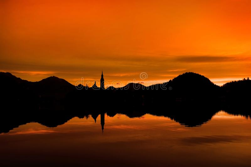 Church of the Assumption, Bled. The church of the assumption reflection during sunset, Bled, Slovenia royalty free stock photo