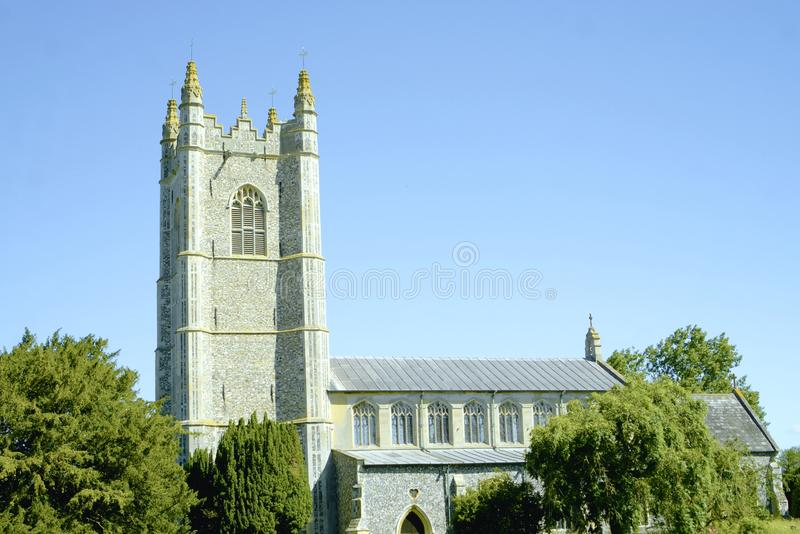 English parish church at Redenhall. The Church of the Assumption of the Blessed Virgin Mary tower which looks down on the surrounding villages in Norfolk UK royalty free stock image