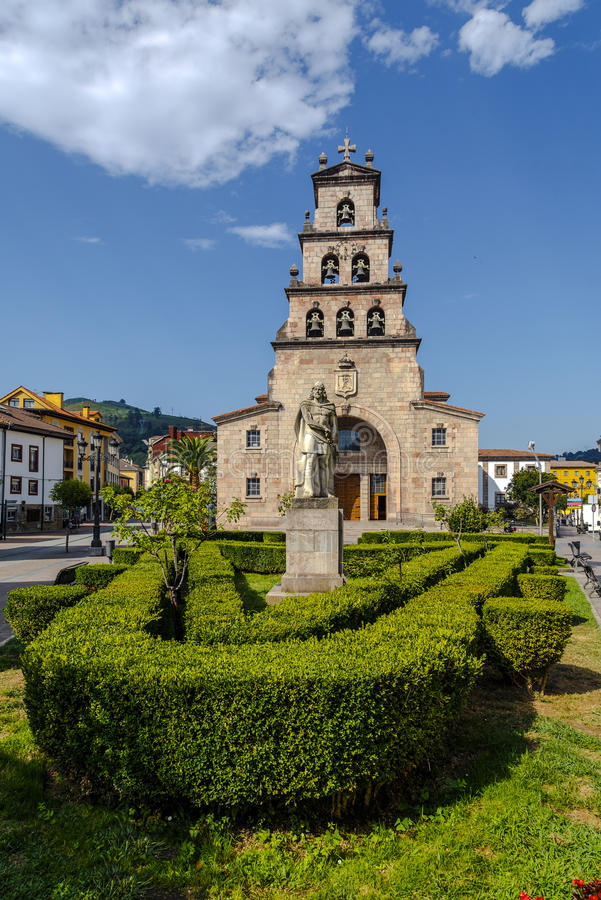 Church of the Assumption of Cangas de Onis and Pelayo. Church of the Assumption of Cangas de Onis, Asturias Spain and Statue of Don Pelayo, first king of Spain stock photos