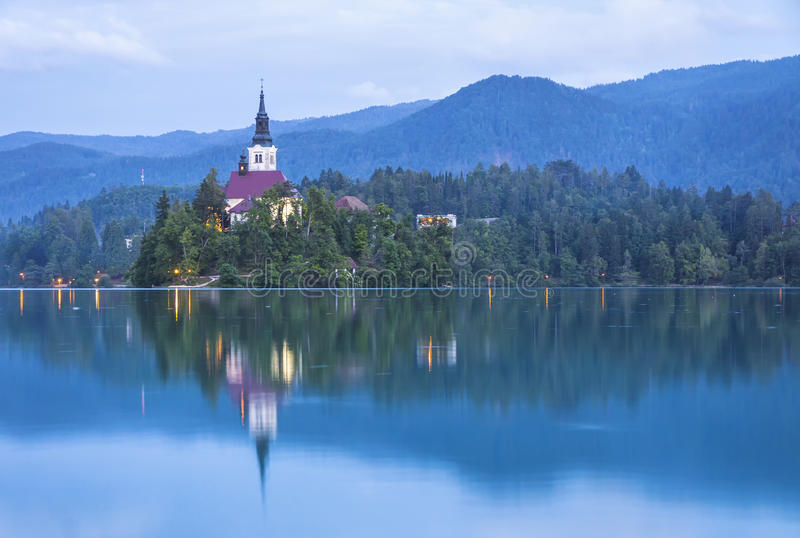 Church of the Assumption on the island of Bled lake, Slovenia. Atmospheric picturesque view of Church of the Assumption on the island of Bled lake, Slovenia royalty free stock photos
