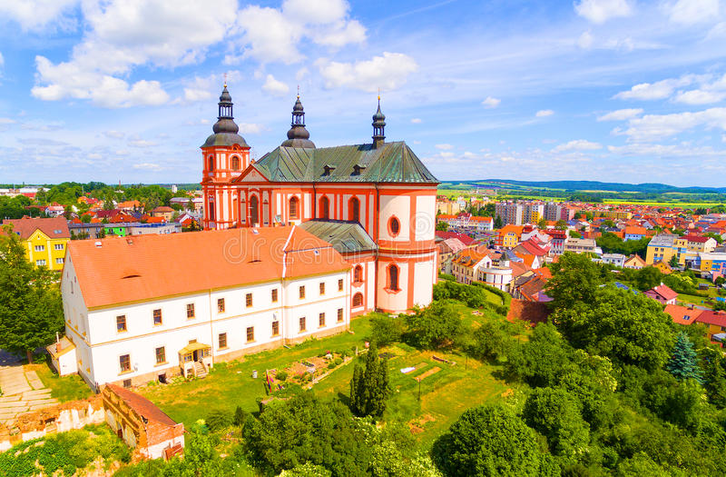 Church of The Assumption. Church of The Assumption 1775 in small town Prestice. Architecture from above. Rare baroque monument in Czech Republic, Central Europe stock photo