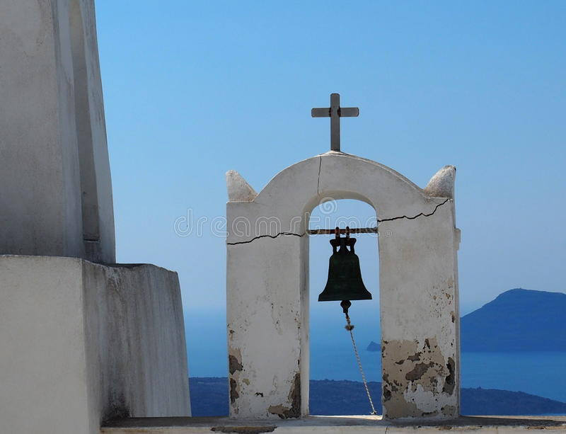 Church Bell And Cross In Fira Santorini Greece stock photos