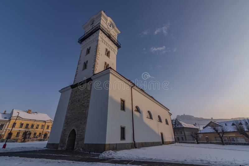 Church of birth of saint Mary in Spisske Podhradie town. In frosty cold winter snow morning royalty free stock photos