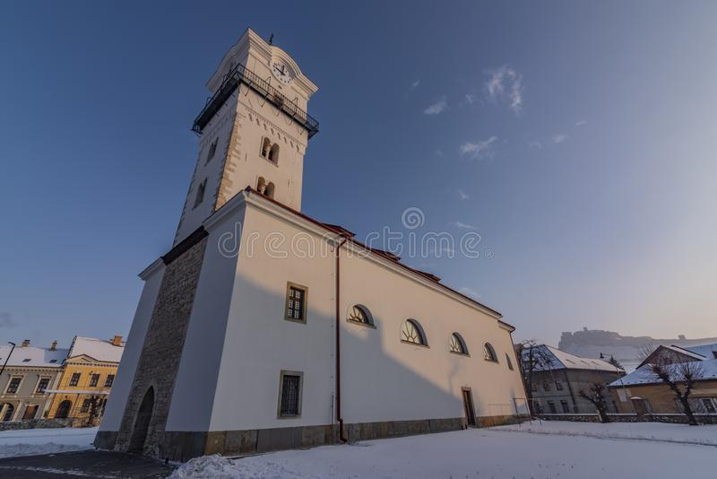 Church of birth of saint Mary in Spisske Podhradie town. In frosty cold winter snow morning stock photos