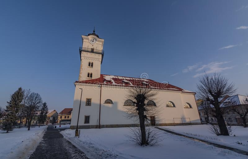 Church of birth of saint Mary in Spisske Podhradie town. In frosty cold winter snow morning stock image