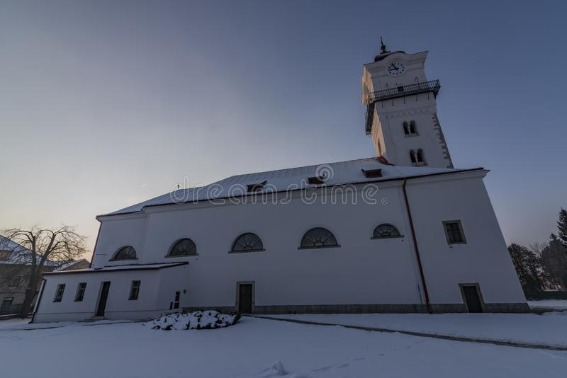 Church of birth of saint Mary in Spisske Podhradie town. In frosty cold winter snow morning royalty free stock image