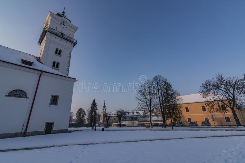 Church of birth of saint Mary in Spisske Podhradie town. In frosty cold winter snow morning royalty free stock images
