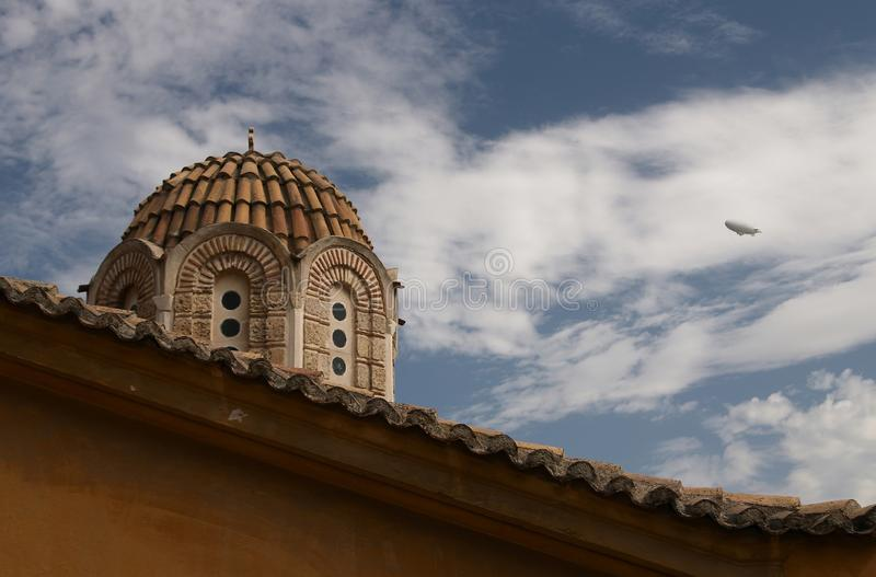 Church, blue sky, white clouds, airship stock photo