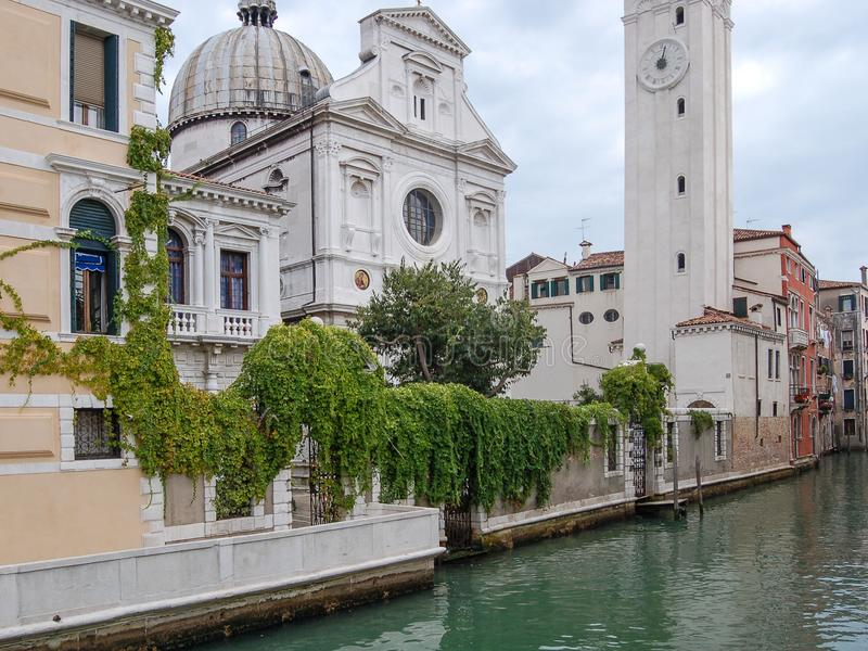 Church, canal,palaces, boats and old brick houses in Venice, Italy, Europe. Venice panorama: Church ,canal,palaces, gondola, boats and old brick houses in Venice stock image