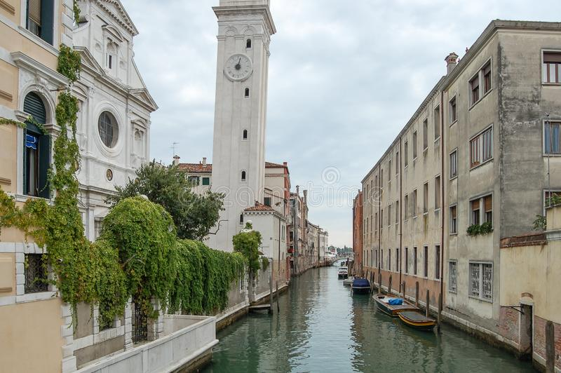 Church canal,palaces, boats and old brick houses in Venice, Italy, Europe. Venice panorama: Church ,canal,palaces, gondola, boats and old brick houses in Venice stock photo