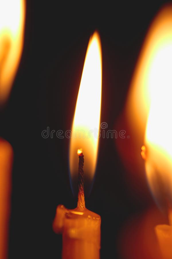 Church candle burning in the dark creates a spiritual atmosphere. A church candle burning in the dark creates a spiritual atmosphere. Hope. Prayer. sorrow, faith royalty free stock images